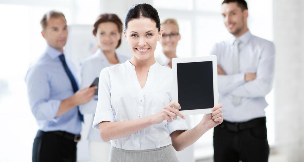 Typical stock photo with smiling women holding iPad